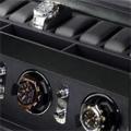 Коллекция Шкатулка для наручных часов 16 наименований стоимостью от 24990 до 89990 руб. Получить в подарок стильную шкатулку для подзавода и хранения часов от одного из самых известных в мире производителей теперь стало реальностью. Равно как и возможность сделать аналогичный подарок своим друзьям и близким. Упрощенный  дизайн и внешняя прямолинейность конструкции компенсируется богатой отделкой корпуса из кожи высокого качества. Каждая модель оснащена двумя отделениями:  для завода часов и для их хранения. Имеются и позиции, функциональность которых немного сужена: например, шкатулка для наручных часов без дополнительного отсека для хранения. Богатый выбор моделей позволяет выбрать изделие нужного дизайна